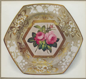 """Hexagonal plate. (With three transverse indentations dividing border into six compartments. The central panel with deep gold frame decorated with roses in the Billingsley manner. Border decorated with floral sprays gilded, and in white in relief. Marked """"SPODE"""" 2057 in red.)"""
