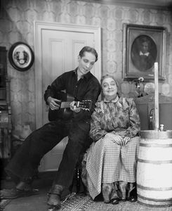 Franchot Tone as Curly McClain (with the guitar) & Helen Westley as Aunt Eller Murphy.