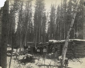 [Settlers in front of their log homes, Saskatchewan.]