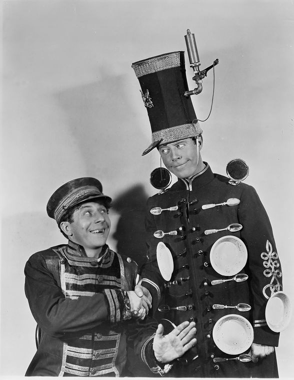 Joe Cook as Joe Squibb and Dave Chasen as Wiffington in Fine and Dandy.