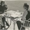 Margaret Sullavan and Leland Hayward outside at table