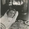 Margaret Sullavan lying by fireplace