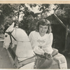 Margaret Sullavan with antique carousel horse