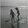 Bridget Hayward and Brooke Hayward playing on the beach
