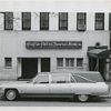 View of Griffin-Peters Funeral Home, in Harlem, New York, with funeral home's hearse parked in front