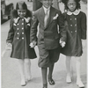 Church is out: Edward Jones (center) escorting Pat Roberts and Edna Dean home from church, Harlem, New York City