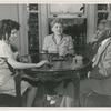 Philippa, Josephine and George Schuyler at home, playing dominoes, circa mid-1940s.