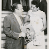 "Tennis player Althea Gibson with New York City mayor Robert F. Wagner, posing with copy of Gibson's record album ""Althea Gibson Sings"""