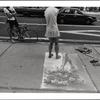 Armless street artist.