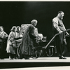 Zero Mostel in the stage production of Fiddler on the Roof as Tevye (pulling cart with family behind him)
