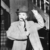 Lucille Ball in the television production I Love Lucy (bowler hat and cigar).