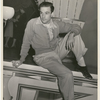 Gene Kelly resting offstage at the nightclub Billy Rose's Diamond Horseshoe