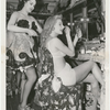 Two showgirls in dressing room preparing for performance at the nightclub Billy Rose's Diamond Horseshoe