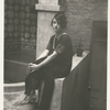 Dorothy Parker in backyard of residence at 412 West 47th Street, New York City.