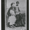 Portrait of Sea Island School teacher Miss Harriet W. Murray, with students Elsie and Puss, Feb. 1866.