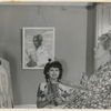 Philippa Schuyler (center) sitting for her mother Josephine, who is painting a portrait of her, circa 1944-45. A portrait of George Schuyler, also painted by Josephine, hangs on wall behind Philippa.