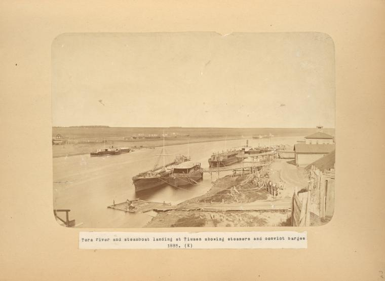 [Tura river and steamboat landing at Tiumen showing steamers and convict barges 1885. (K).]