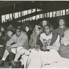 Kenny Washington (foreground, seated fourth from right) and Woody Strode (foreground, seated second from right) of the Los Angeles Rams professional football team, and the first two African American football players to integrate the modern National Football League, on the sidelines during a game between the Rams and the New York Giants, at the Polo Grounds, in Harlem, New York City, 1946
