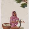 Seated female fishmonger in pink sari