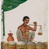 Seated male spice/salt vendor holding a balance