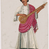 Musician with stringed instrument in white shirt and red scarf