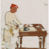 Man in white ironing at table