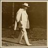 Six photographs of SLC strolling in white suit at Tuxedo, Aug. 1907. SLC walking towards camera.