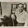 Portrait of writer Langston Hughes with his typewriter
