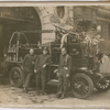 New York City fire fighter Wesley A. Williams, (right) with two of his fellow fire fighters posing with a fire truck at Engine Company No. 55, in Manhattan's Lower East Side
