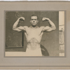 Studio portrait of New York City fire fighter Wesley A. Williams in a body building pose