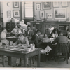 View of researchers using the Schomburg Collection, when it was the 135th Street Branch Library Division of Negro Literature, History and Prints, as it looked in 1938, with Catherine A. Latimer, reference librarian of the collection, in left background.