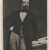 Mounted photograph of Charles Dickens]