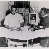 An unidentified African American physician, assisted by a nurse, treating a baby born with a club foot at an unidentified public health clinic, circa 1945