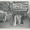 A group of Ballet Theatre dancers standing on the sidewalk near the Warner Theatre, no. 11