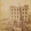 """The crated obelisk """"Cleopatra's Needle"""" being lowered to a horizontal position"""