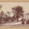Horse carriages and pedestrians on Riverside Drive