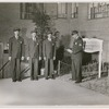 Group portrait of security officers at Riverton Houses administration office, in Harlem, New York City