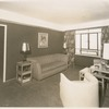 View of living room in apartment unit of the Riverton Houses, in Harlem, New York City, circa 1947