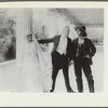 Scene from the motion picture Call of Her People (bride and two men standing)