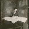 Studio portrait of Bessie J. Bearden, the first black woman elected to local School Board No. 15, in New York City, signing high school diplomas, circa 1930