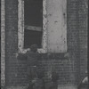 Children in the windows of an abandoned building