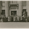 Group portrait showing Bessye Bearden (front row, right of center), with an unidentified group posing outside the Royal Bank of Canada, in Montreal, circa late 1910s