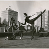 Dancer John Jones (left) with unidentified female dancer, performing on rooftop, when he was a member of choreographer Antony Tudor's dance class at the Ballet Guild, Philadelphia, ca. 1954