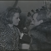 Jane Fonda in dressing room with unidentified man during opening night performance of the stage production There Was a Little Girl