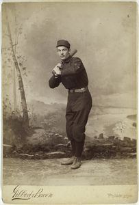 [Unidentified baseball player in dark uniform - batting form.]