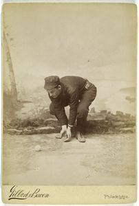 [Unidentified baseball player in dark uniform - catching form - bent.]