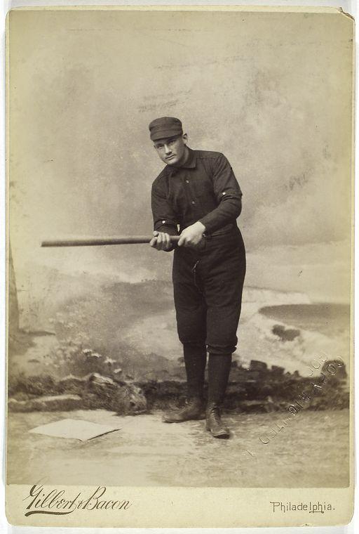 [Unidentified baseball player in dark uniform - batting form.]