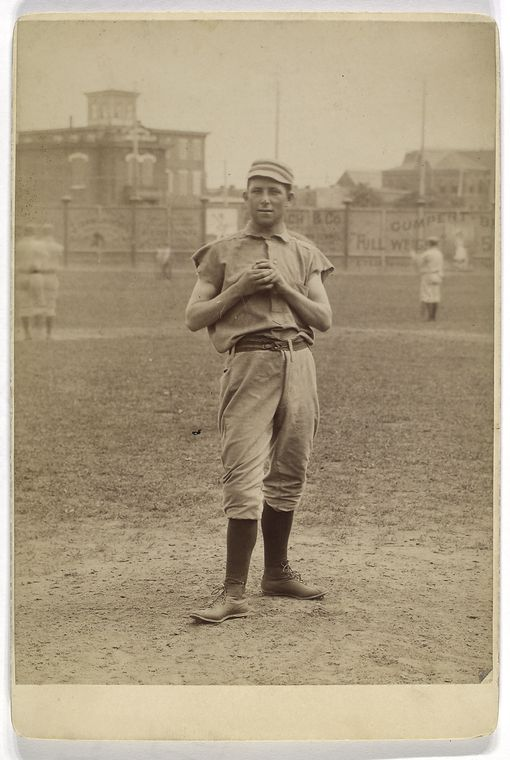 [Unidentified baseball player in pitching form.]