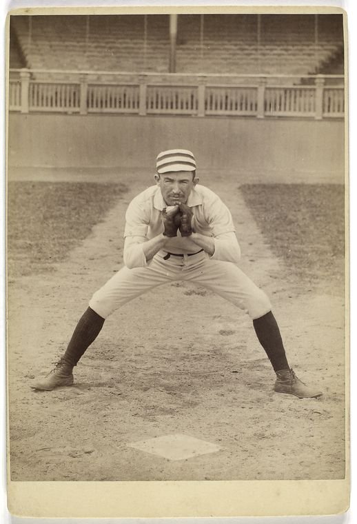 [Unidentified baseball player in catching form.]
