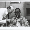 George Avakian and Louis Armstrong (seated) at Satch Plays Fats recording session